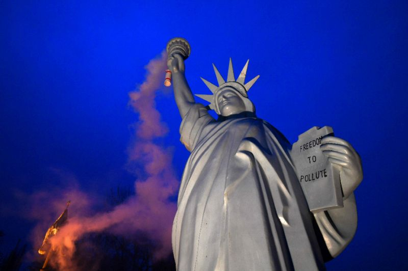 An alternative Statue of Liberty emitting smoke from the torch, created by Danish artist Jens Galschiot and displayed at the Rheinaue park during the climate talks in Bonn