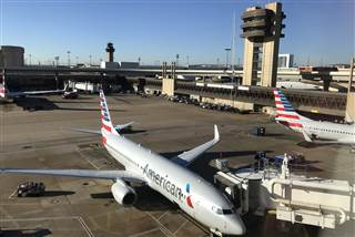 Image: An American Airlines plane sits at the gate at Dallas Fort Worth International Airport