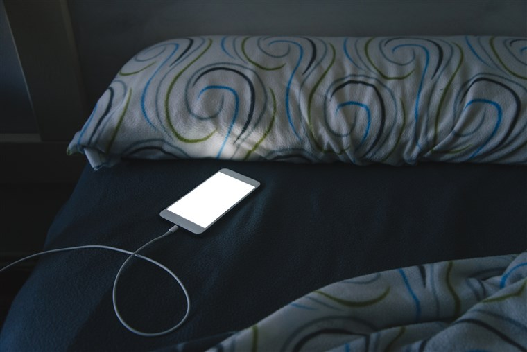 Image: Mobile phone in bed