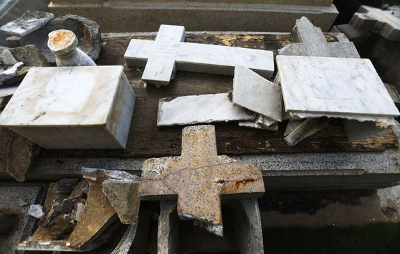 Broken headstones pile up in a cemetery in the immediate aftermath of Hurricane Maria.