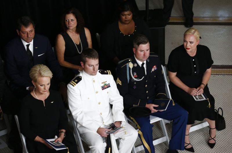 (L-R front) Cindy McCain, wife of US Senator John McCain, with her sons Jack, Jimmy, and daughter' Meghan and Bridget (R rear), attend the memorial service for Snator McCain at the Arizona Capitol on August 29, 2018, in Phoenix.