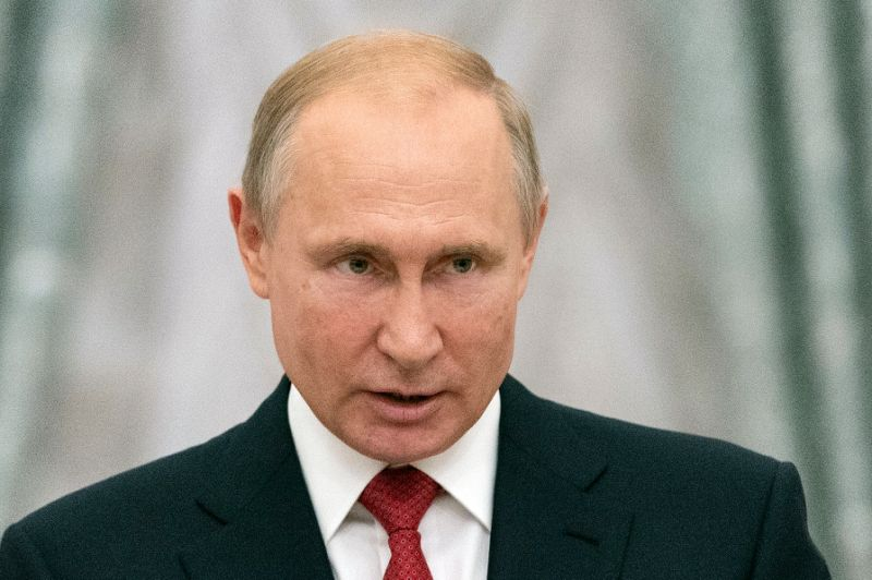 Russian President Vladimir Putin said he wants to lure scientists from all over the world
