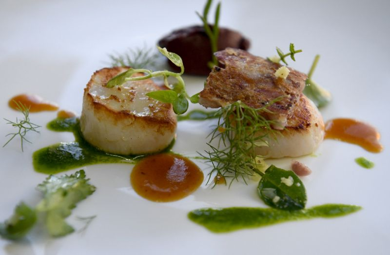 Seared scallops -- a prized seafood delicacy (AFP Photo/FRED TANNEAU)