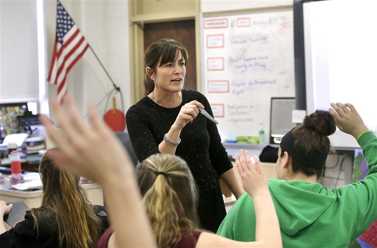 """Image: High school teacher Natalie O'Brien, center, calls on students during a civics class called """"We the People,"""""""