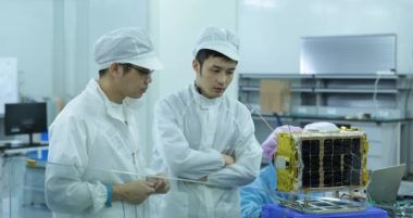 Spacety employees monitor a satellite undergoing testing. Credit: Spacety