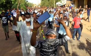 Sudanese demonstrators chant slogans as they march along the street during anti-government protests in Khartoum, Sudan December 25, 2018