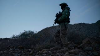 A member of Constitutional Patriots New Mexico Border Ops Team militia is pictured on patrol at the US-Mexico border