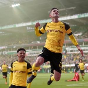 Pulisic celebrates scoring against Werder Bremen with Jadon Sancho.