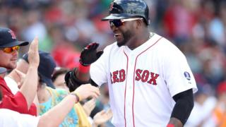 Boston Red Sox hitter David Ortiz celebrates his solo home in the sixth inning against the Toronto Blue Jays in a September 2013 file photo
