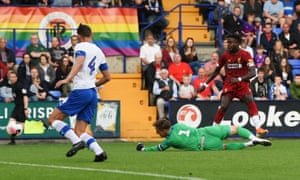 Divock Origi scores Liverpool's fifth goal of the night at Prenton Park.
