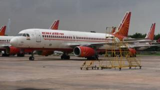 Air India planes are pictured at Indira Gandhi International Airport in New Delhi on September 10, 2018.