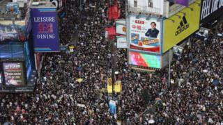Tens of thousands throng Hong Kong's streets