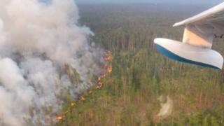 A Russian firefighting aircraft tackle a fire in the Krasnoyarsk region. Photo: 30 July 2019