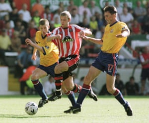 Martin Smith gets past Palace's Dean Austin and Andy Linighan during a Division One encounter in 1999.