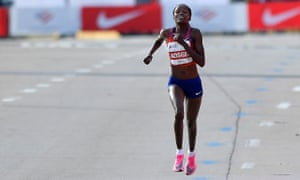 Brigid Kosgei wins the Chicago marathon in a world record time this month.