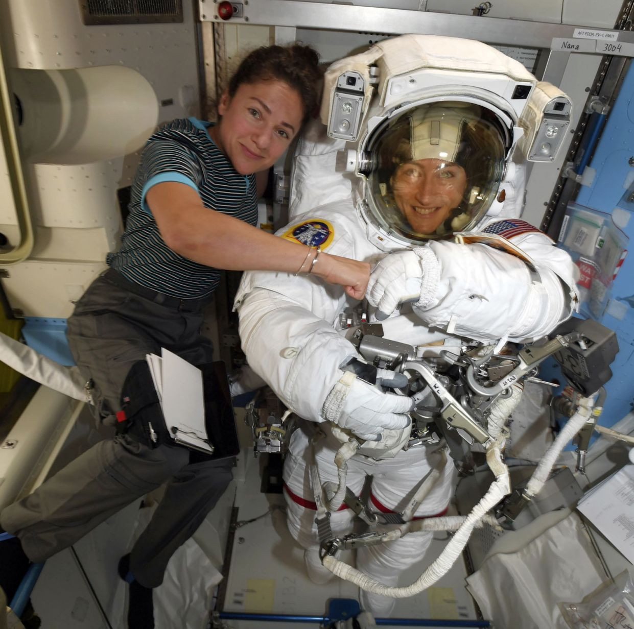 Astronauts Jessica Meira, left, and Christina Koch on the International Space Station. (NASA via The New York Times)