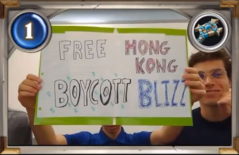 "Illustration for article titled College Hearthstone Players Hold Up ""Free Hong Kong, Boycott Blizzard"" Sign On Stream"