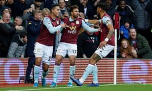 Aston Villa's Trezeguet celebrates scoring their first goal with teammates.