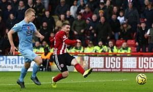 John Fleck of Sheffield United scores his team's third goal.