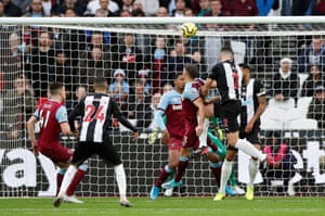 Newcastle United's Ciaran Clark heads the Magpies into the lead.