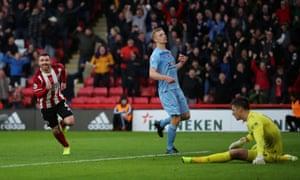 Sheffield United's John Fleck wheels away in celebration after scoring their third goal.