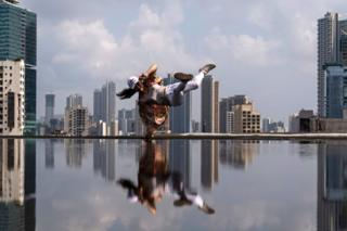 Japanese breakdancer Ami Yuasa, dances during a photo session at the he Red Bull BC One World Championships in Mumbai