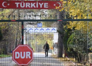 An alleged IS member stands in a no man's land at the border between Turkey and Greece near Pazarkule, on 11 November 2019