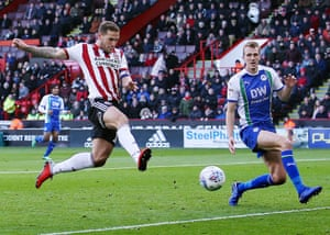 Billy Sharp of Sheffield United scores to make it 3-1 against Wigan Athletic in their Championship match at Bramall Lane in October 2018.
