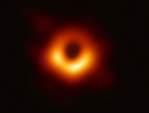 This image from the Event Horizon Telescope shows the supermassive black hole in the elliptical galaxy M87, surrounded by superheated material. (EHT Collaboration)