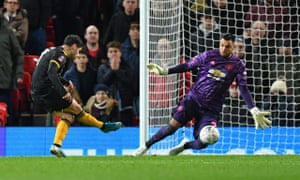 Wolves' Neto rifles past Sergio Romero in the first half only for the effort to be disallowed by VAR for handball.