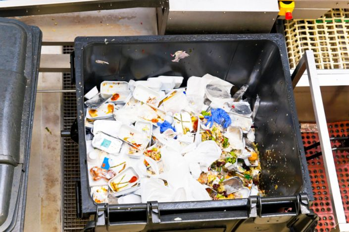 Leftovers of airline food in a large waste container from in-flight service. (Photo: Wicki58 via Getty Images)