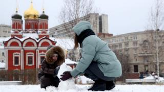 Russian child plays in park with his mother in Moscow (9 January)