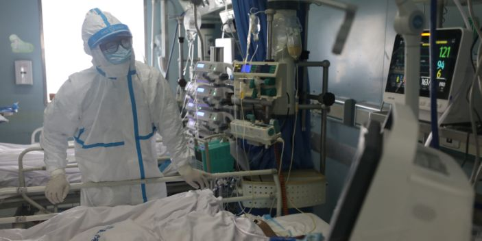 A medical worker is seen at the intensive care unit of Jinyintan hospital in Wuhan, Hubei province.