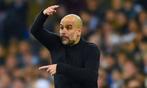 Pep Guardiola directs his Manchester City players at the Bernabéu.
