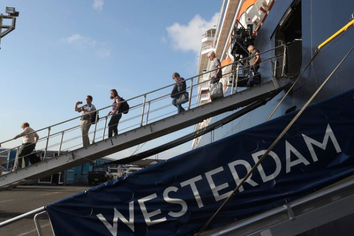 Passengers of the MS Westerdam, owned by Holland America Line disembark from the MS Westerdam, at the port of Sihanoukville, Cambodia, Saturday, Feb. 15, 2020.