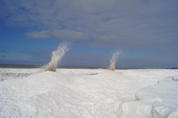 """Ice volcanoes"" erupt on Lake Michigan."