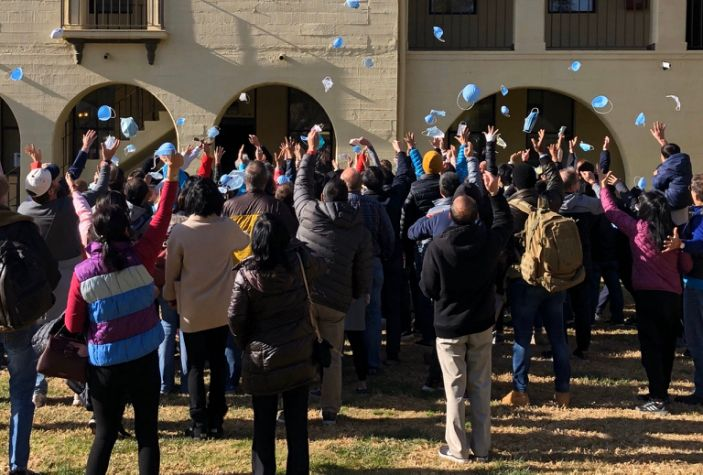 Dozens of US citizen who had been evacuated from Wuhan, China throw their face masks up in the air after their quarantine ended in California, February 11, 2020
