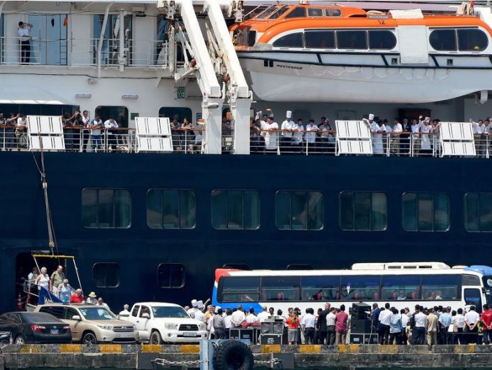 Crew members waved as Westerdam passengers disembarked in Sihanoukville, Cambodia, on February 19, 2020.