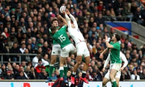 Ireland's full-back Jordan Larmour is beaten to the high ball.