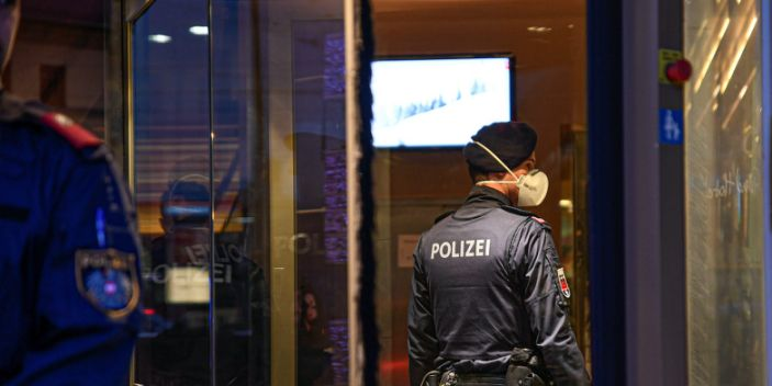 A policeman wears a respirator mask as he enters the Grand Hotel Europa, after authorities put the Hotel under isolation as an employee was tested positive on the new coronavirus in Austria, in Innsbruck, Austria February 25, 2020.