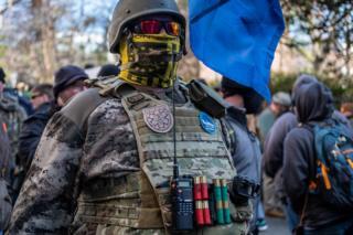 A gun rights activist defies Virginia's no masking law at the Lobby Day rally