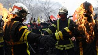 Firefighters set each other alight during a protest in the centre of Paris on 28 January