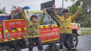 Fire crew in Australia celebrate the arrival of rain