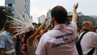 """A man wears a T-shirt emblazoned with a fake government department, the """"Ministry of Counterculture"""""""