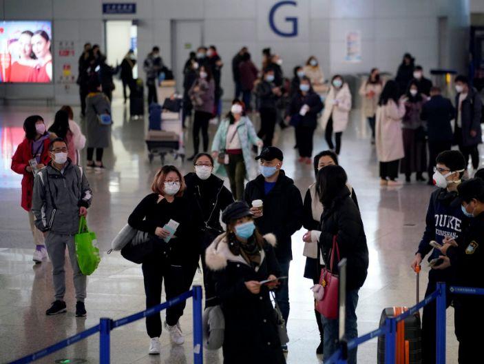 Passengers wearing masks are seen at Pudong International Airport in Shanghai, China Jan. 27, 2020.