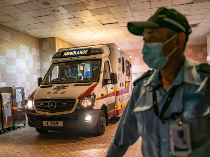 A security official stands guard as an ambulance arrives with a patient to the Infectious Disease Center of Princess Margaret Hospital on January 22, 2020 in Hong Kong.