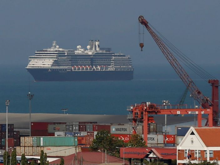 After being refused by five ports over fears that someone aboard may have coronavirus, the Westerdam is seen arriving in Sihanoukville port in Cambodia.