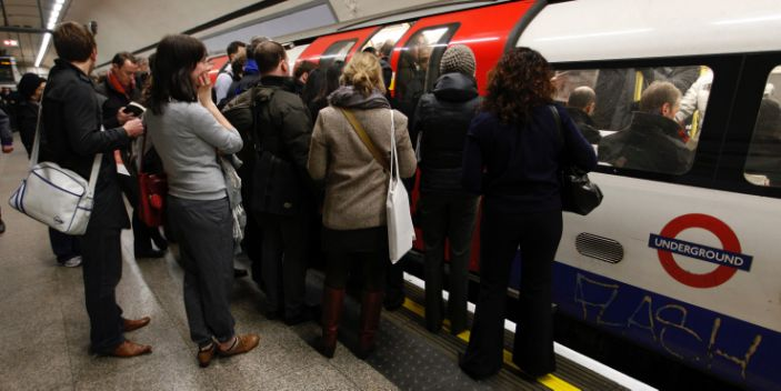 Travellers queue as the doors close on a packed rush hour tube train in central London in 2010.