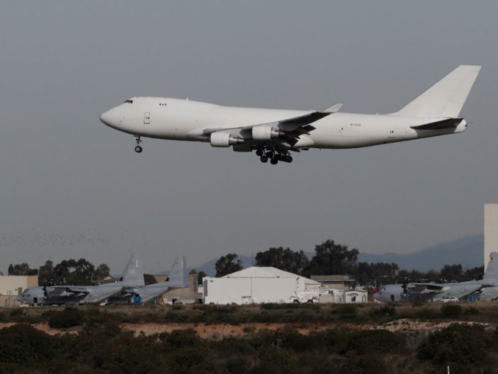 A plane carrying evacuees from the virus zone in China lands at Marine Corps Air Station Miramar Wednesday, Feb. 5, 2020, in San Diego. One of two jets carrying Americans fleeing the virus zone in China landed Wednesday morning at Miramar after first landing at an Air Force base in Northern California. Some will be quarantined at a hotel on the base for 14 days while others will be quarantined at a Southern California military base, officials said. (AP Photo/Gregory Bull)