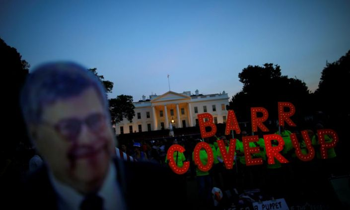 """<span class=""""element-image__caption"""">A cardboard cutout of William Barr is seen as protesters hold signs which read """"Barr Coverup,"""" following the release of the Mueller report on 18 April 2019.</span> <span class=""""element-image__credit"""">Photograph: Carlos Barría/Reuters</span>"""